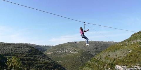 Sport of sliding on rope slide in mountains witnesses turnout in Tartous countryside
