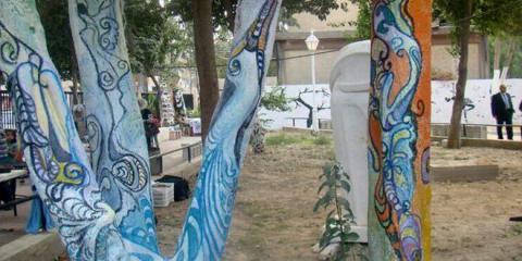 Syrian artists turn trees into creative works of art