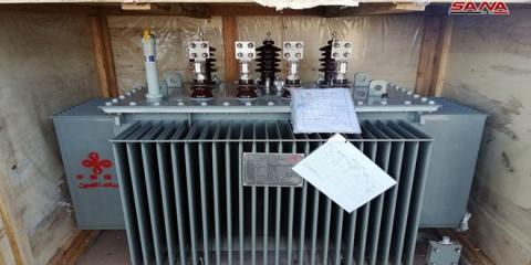 800 electrical power transformers arrived in Lattakia as a grant from China