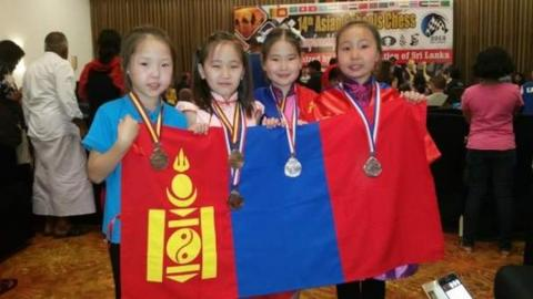 JUNIOR CHESS PLAYERS CLAIM GOLD MEDALS