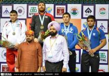 Iranian free style wrestler Parviz Hadi wins the 1st gold medal in Asian Champio